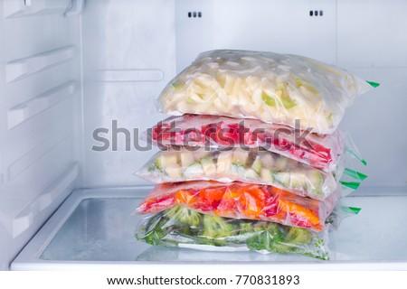 Frozen vegetables in bags in refrigerator