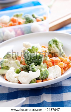 frozen vegetables on white plate - stock photo
