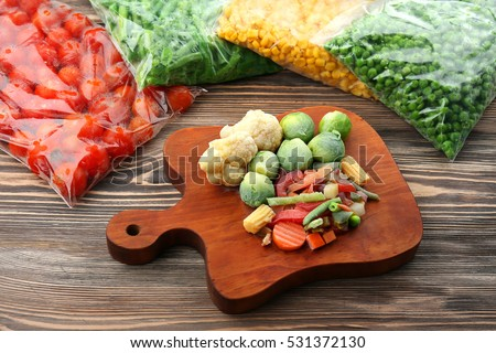 Frozen vegetables on wooden board #531372130