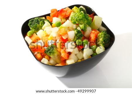 Frozen vegetables with ice crystals and frost in the steel cup on a white background