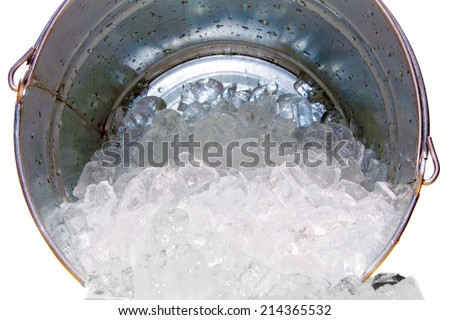 Frozen Water Aka Ice In Cube Form Spills Out Of A Steel Ice Bucket ...