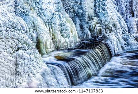Frozen waterfall water view. Waterfall ice frozen. Frozen waterfall water flow
