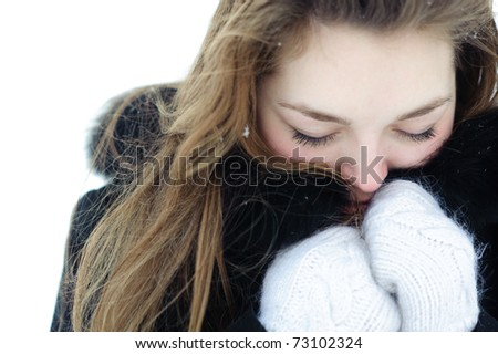 Frozen woman heated by mittens and a fur from hood