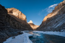 Frozen Zanskar river, with Indian Himalayas in late afternoon light