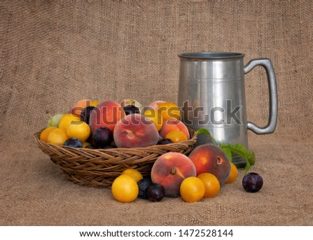 Fruit and ale. Old fashioned fruit from a long abandoned orchard with pewter tankard. Still life. #1472528144