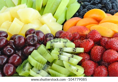 Fruit and berry mix: pineapple, kiwi, cherry, apple, strawberry, mulberry, apricot, peach
