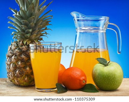 Fruit and juice on a wooden table, Still life