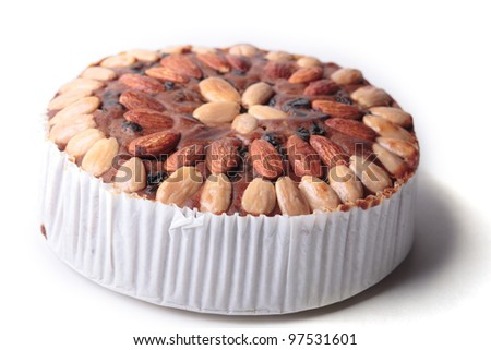 Fruit and nut cake on white background, selective focus