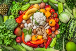 Fruit and vegetables background colorful overhead large various mix in studio