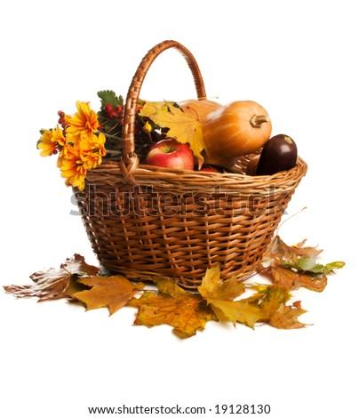 Fruit and vegetables, lying in wicker basket, isolated