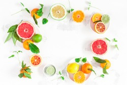 Fruit background. Colorful fresh fruits on white table. Orange, tangerine, lime, lemon, grapefruit. Flat lay, top view, copy space