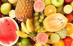Fruit background, many fresh fruits mixed.