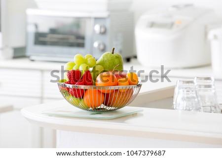 Fruit basket in bright kitchen