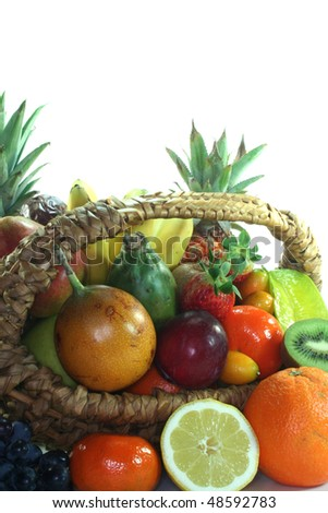 Fruit basket with various indigenous and exotic fruits on white background