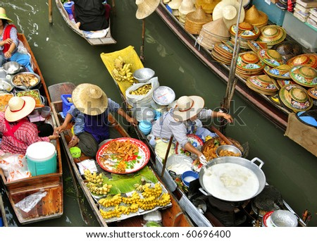 stock photo : Fruit boats at Damnoen Saduak floating market in Thailand.