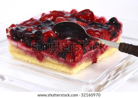 fruit cake in glass plate on white background