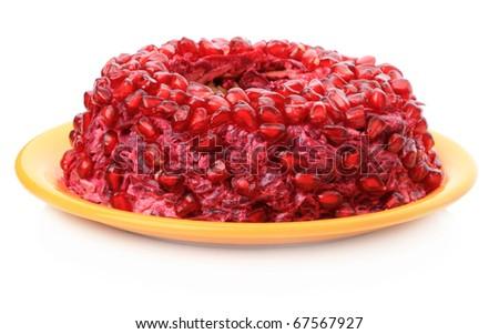 Fruit cake with pomegranate seeds isolated on white background