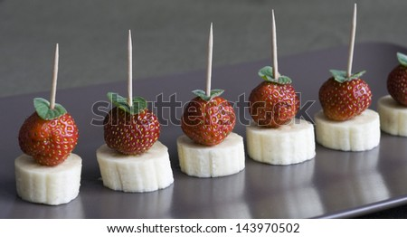 Fruit canape - banana and strawberry with mint leaf
