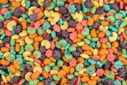 Fruit cereal naturally and artificially fruit flavored sweetened corn puffs. Cereal fruity shapes