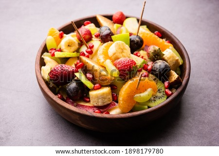 Fruit Chaatis a tangy Indiandishmade by combining chilled juicy fruits like apples, bananas, oranges, grapes with salt and mild spices
