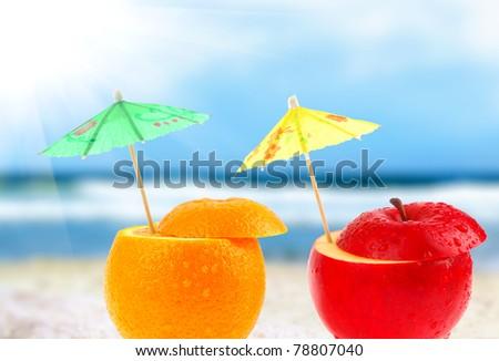 Fruit cocktail on a beach - Shutterstock ID 78807040