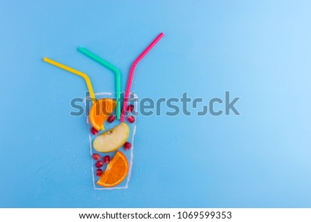 fruit cocktail on blue background. drawning of glass, #1069599353
