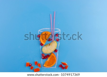 fruit cocktail on blue background. drawning of glass, #1074917369
