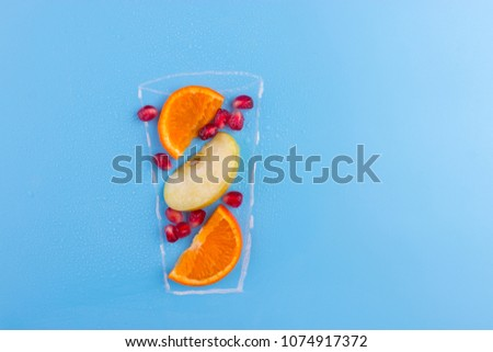 fruit cocktail on blue background. drawning of glass, #1074917372