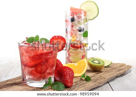 Fruit cocktail over wood background