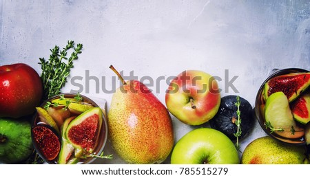 Fruit cocktail with wine, pears, apples and figs, gray background, top view - Shutterstock ID 785515279