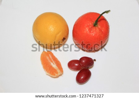 Fruit composition with mandarin, lemon and grape #1237471327