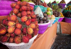 Fruit display on small streetside stall in Bali