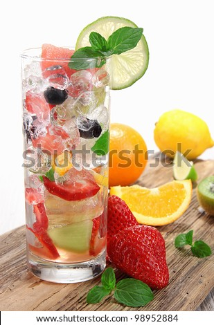 Fruit drink on wooden background