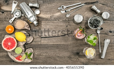 Fruit drinks with ice. Cocktail making bar tools, shaker, glasses. Flat lay.