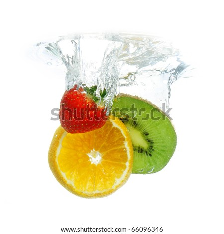 Fruit dropped in water, isolated on white