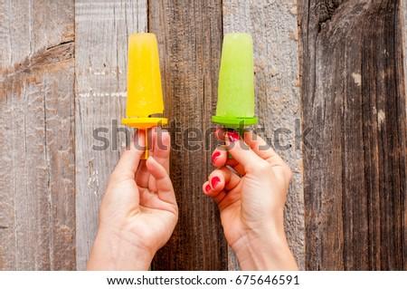 Fruit homemade ice cream. Colorful multi-colored frozen fruit juice. Fresh frozen popsicle #675646591