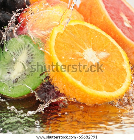 fruit in a spray of water isolated on a white background.