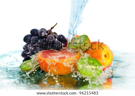 fruit in a spray of water isolated on a white background