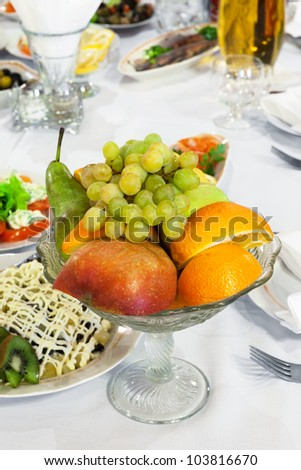 fruit in a vase on the holiday table