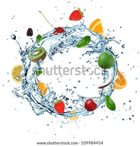 Fruit in water splash on white background - stock photo