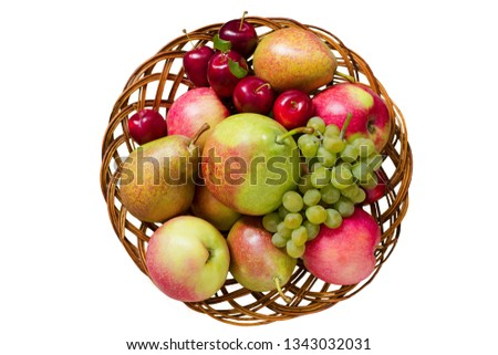 Fruit in wooden basket. Isolated on white background. Top view. Non GMO, or GMO free fresh produce. Autumn harvest concept. #1343032031