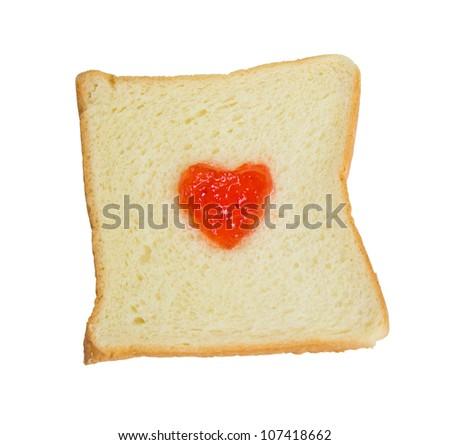 Fruit jam heart shape on slice bread.