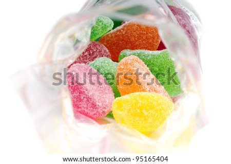 fruit jelly candies in transparent bag, on white background