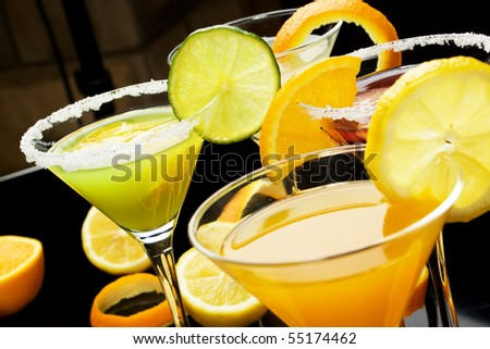 Fruit juice cocktail drink decorated with lemon, lime and orange slices