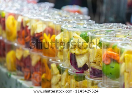 Fruit Juice Fresh fruit in glass for healthy summer treats rich in vitamins for sale in street markets. #1143429524