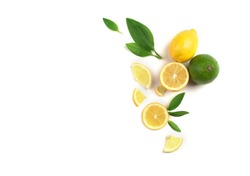 Fruit mix of lemon and lime on a white background with green leaves.