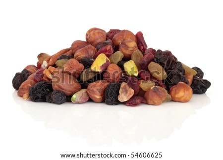 Fruit nut and berry snack food mixture isolated over white background.