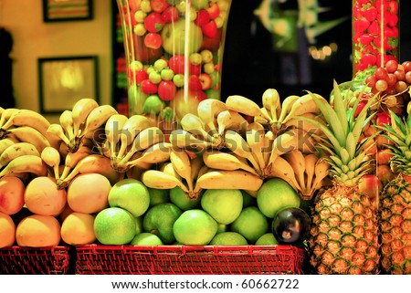fruit on a shop counter in barcelona for preparation of natural juice - stock photo