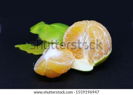 Fruit oranges (other names are Les Oranger, sweet oranges, citrus citrus, Citrus aurantium, Citrus maxima, retina oranges, mandarin) with a black background. #1559196947