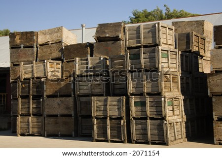 Fruit packing crates sitting on dock of packing house